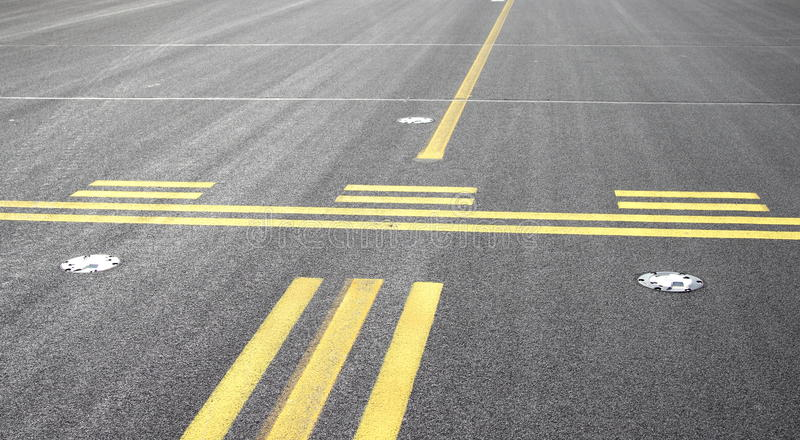 Stop line on airport. In front of runway royalty free stock image