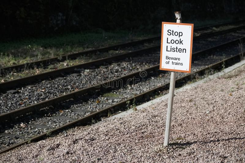 Stop look listen safety road sign at railway train station danger warning sign stock images