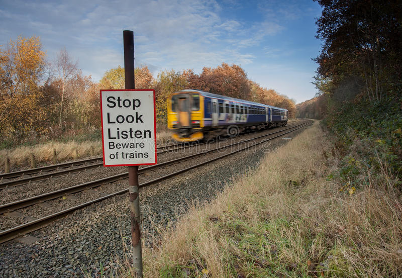 Stop look listen warning at level crossing stock photography
