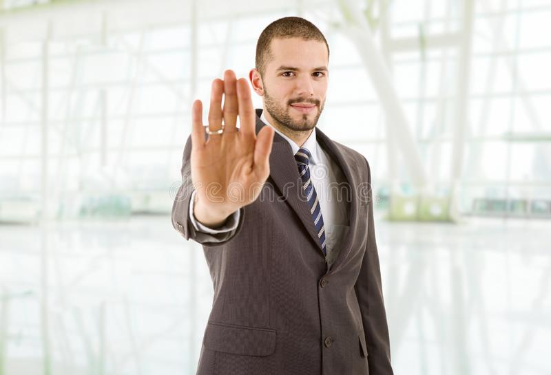 Stop man. Business man making stop with his hand, at the office stock photos