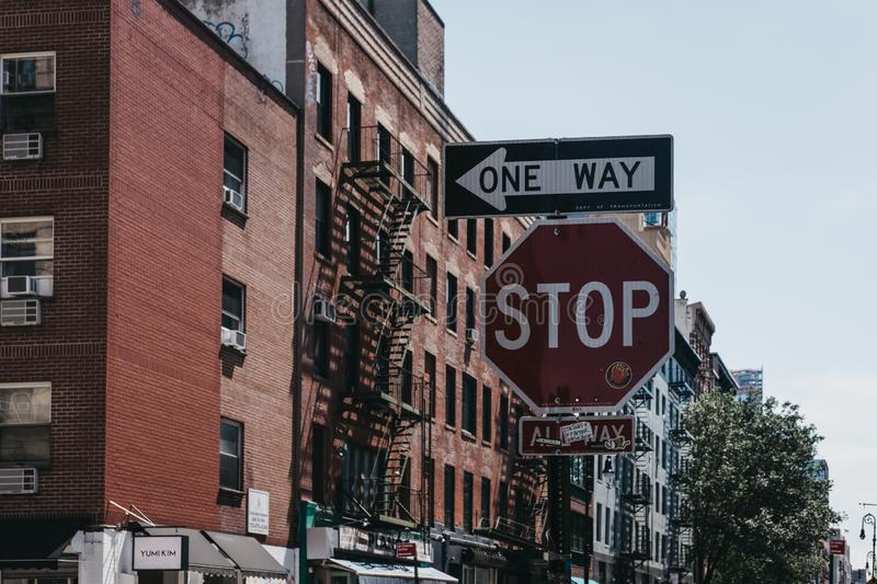 Stop and one way signs on a street in New York, USA. stock photography