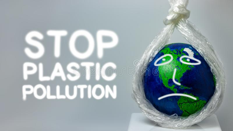 Stop plastic pollution. A plastic stretch film kills the planet earth. stock photography