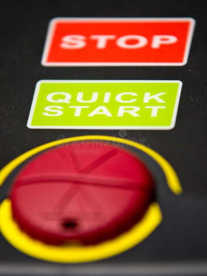 Stop and quick start. Button and equipment detail, button with labels stop and quick start stock photos