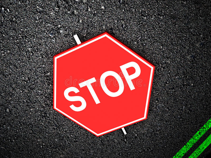 Stop - road sign. On asphalt royalty free stock photography