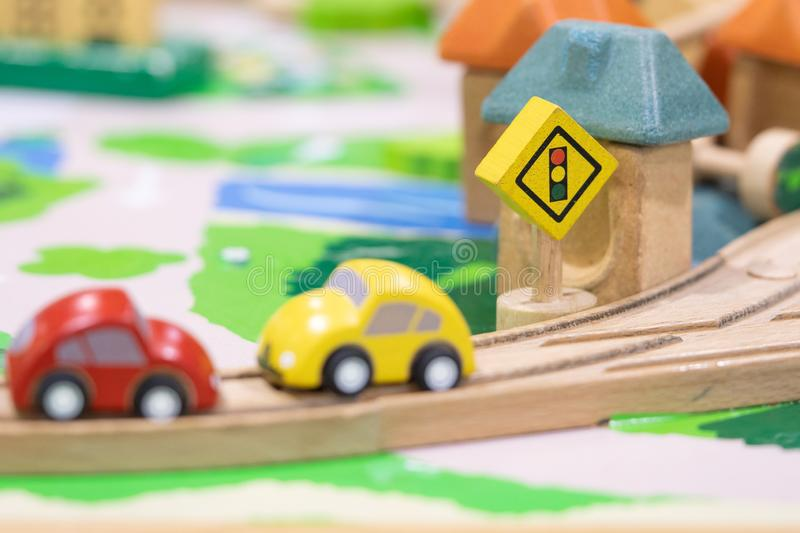 Stop road sign - woden Toy Set Street Signs, cars for kids Play set Educational toys for preschool indoor playground selective. Focus royalty free stock images