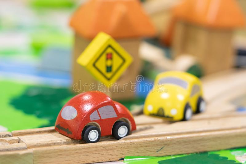 Stop road sign - woden Toy Set Street Signs, cars for kids Play set Educational toys for preschool indoor playground selective. Focus royalty free stock image