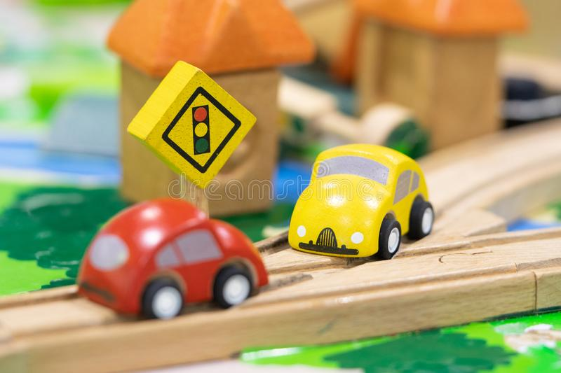 Stop road sign - woden Toy Set Street Signs, cars for kids Play set Educational toys for preschool indoor playground selective. Focus royalty free stock photos