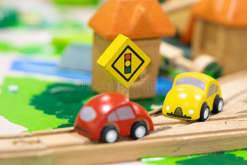 Stop road sign - woden Toy Set Street Signs, cars for kids Play set Educational toys for preschool indoor playground selective. Focus stock photo