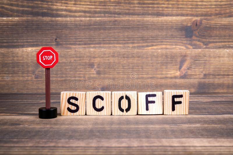 Stop Scoff concept. Wooden letters with road sign royalty free stock photos