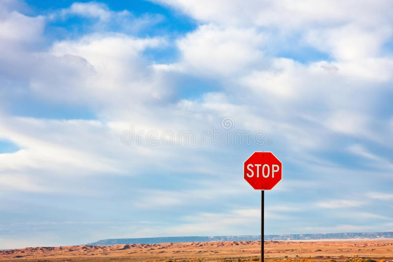 Stop Sign. Against a Dramatic Sky in the Desert royalty free stock photos