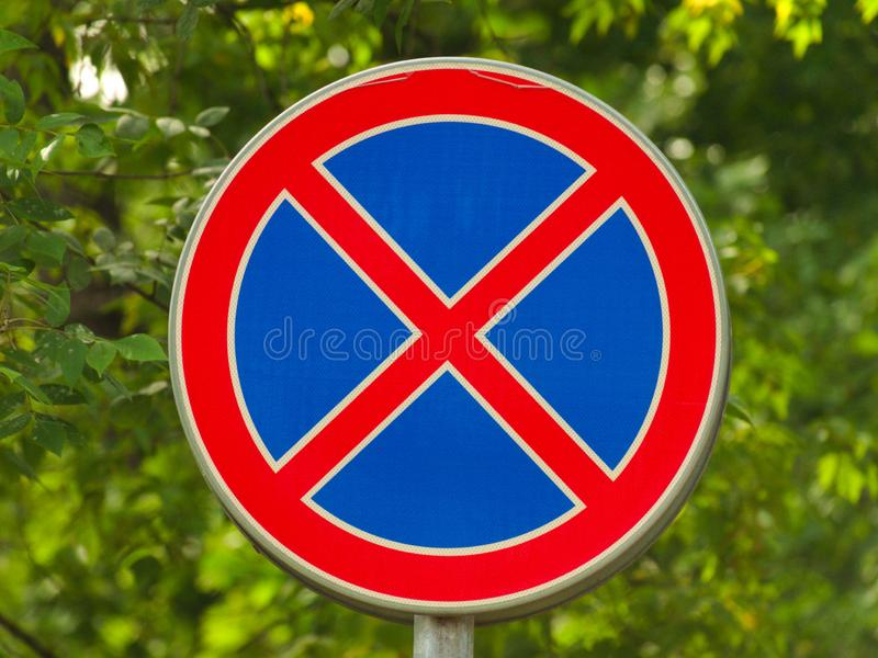 Stop Sign. A no passage stop warning sign with green leaves in the background royalty free stock image