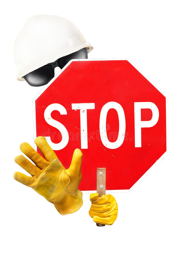 Stop sign. A invisible person with sunglasses a hard hat and gloves holding a scratched stop sign royalty free stock images