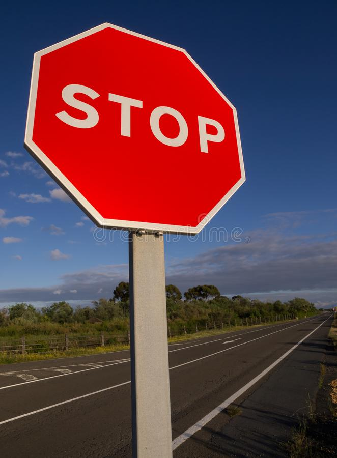 Stop sign against blue sky and clouds.  stock images