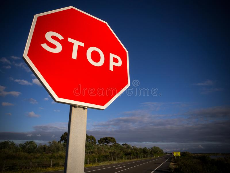 Stop sign against blue sky and clouds.  royalty free stock photo