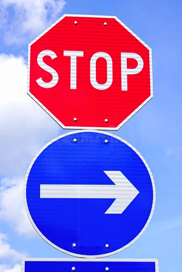 Stop sign and arrow traffic sign stock image