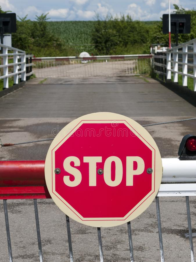 Stop sign. On a barrier of a swing bridge over the Gloucester and Sharpness Canal, UK royalty free stock photography