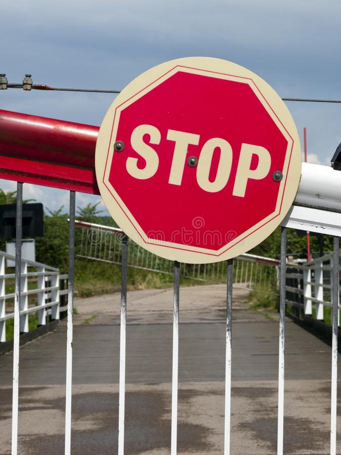 Stop sign. On a barrier of a swing bridge over the Gloucester and Sharpness Canal, UK royalty free stock image