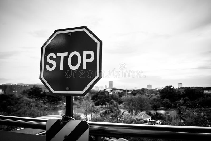 Stop sign. In a black and white image with City Landscape royalty free stock images