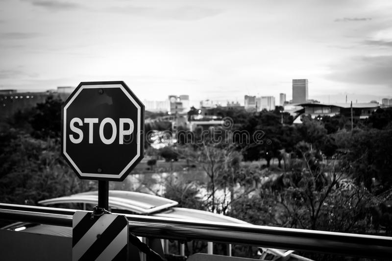 Stop sign. In a black and white image with City Landscape royalty free stock photography