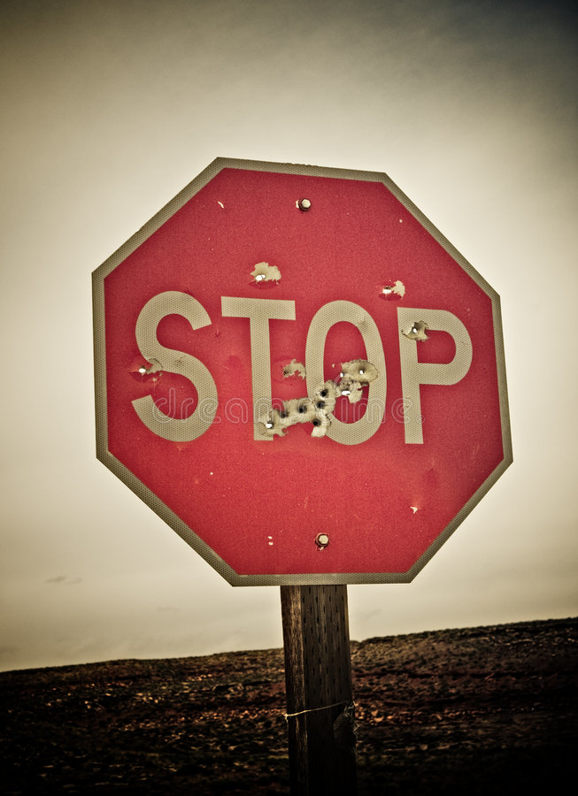 Download Stop Sign With Bullet Holes Stock Photography - Image: 5558202