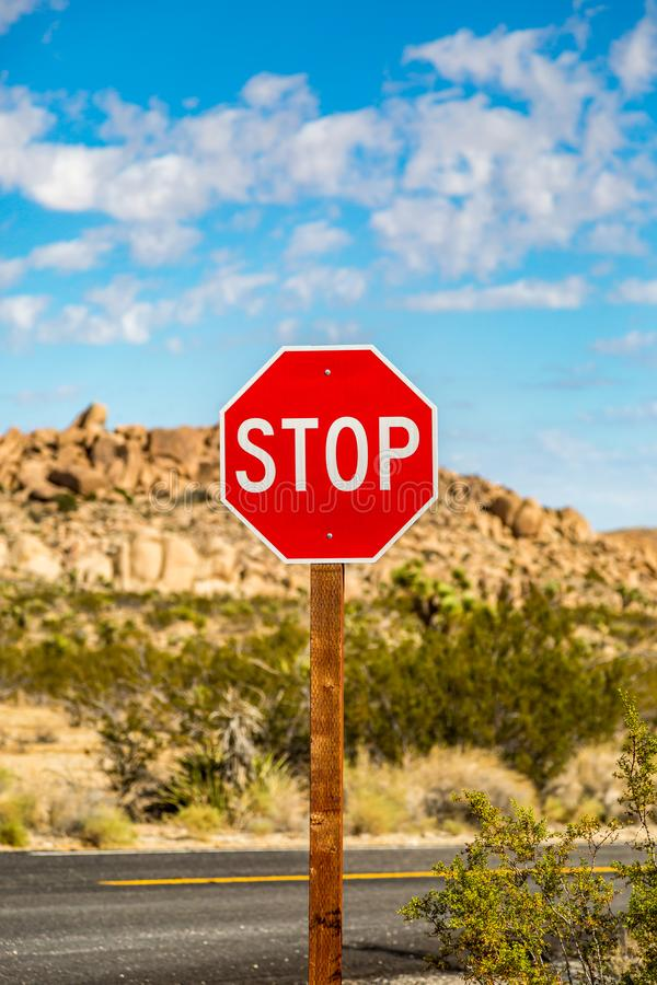 A Stop Road Sign. A STOP sign in California with a rocky landscape behind stock photo