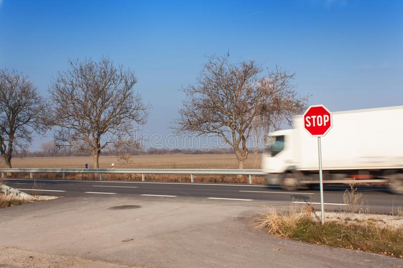 Stop Sign at Crossroads. Rural road. Exit onto the main road. Main road. Dangerous road. Traffic signs stop. stock photo