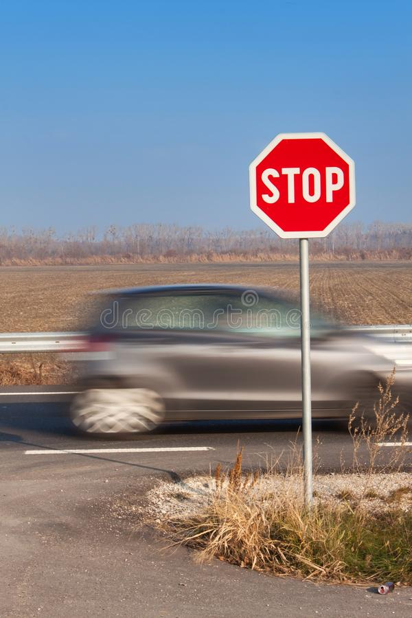 Stop Sign at Crossroads. Rural road. Exit onto the main road. Main road. Dangerous road. Traffic signs stop. royalty free stock images