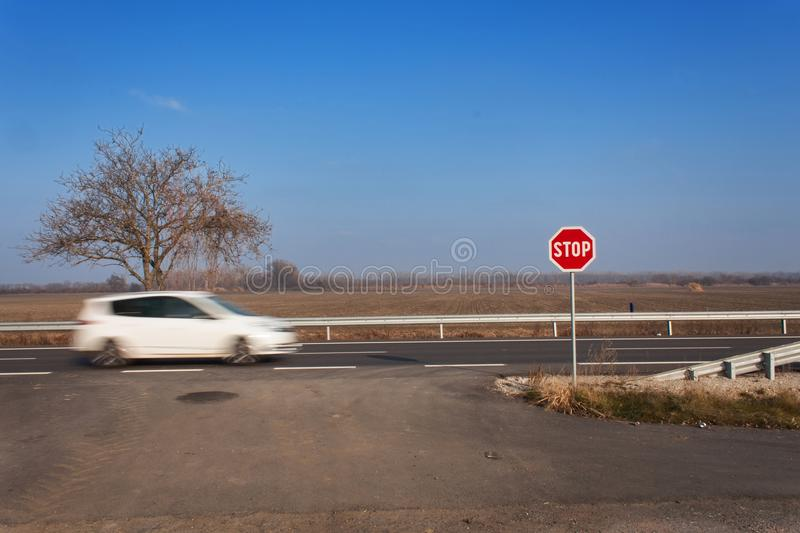 Stop Sign at Crossroads. Rural road. Exit onto the main road. Main road. Dangerous road. Traffic signs stop. royalty free stock photo
