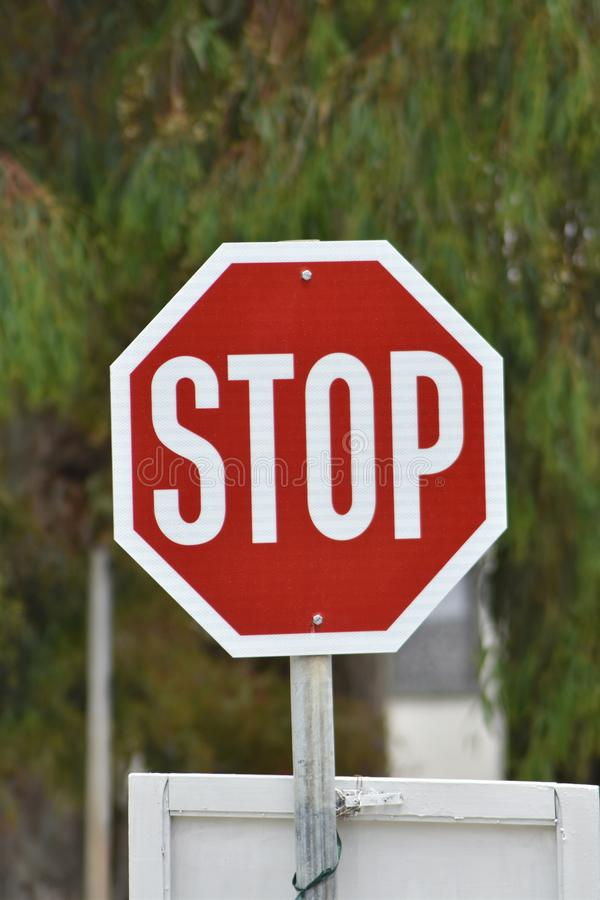 A stop sign on a Greek road. On the Greek island of Ios. A stop sign at a road junction stock photos