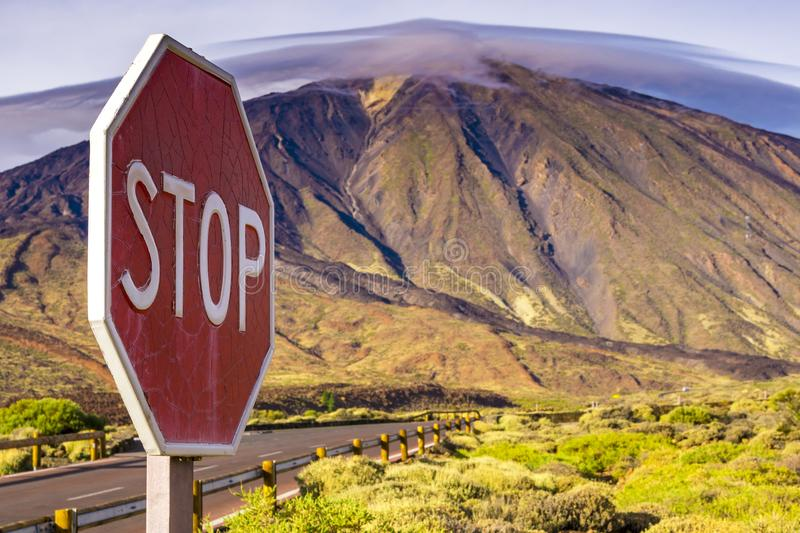 Stop sign in nature mountain landscape road stock photo