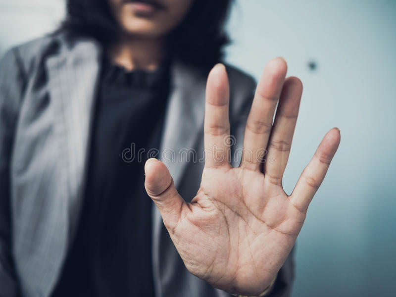 Stop sign with hand. Woman showing stop sign with hand stock image