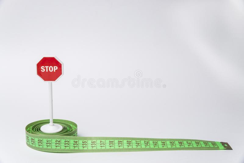 Stop sign and meter on white surface stock photography