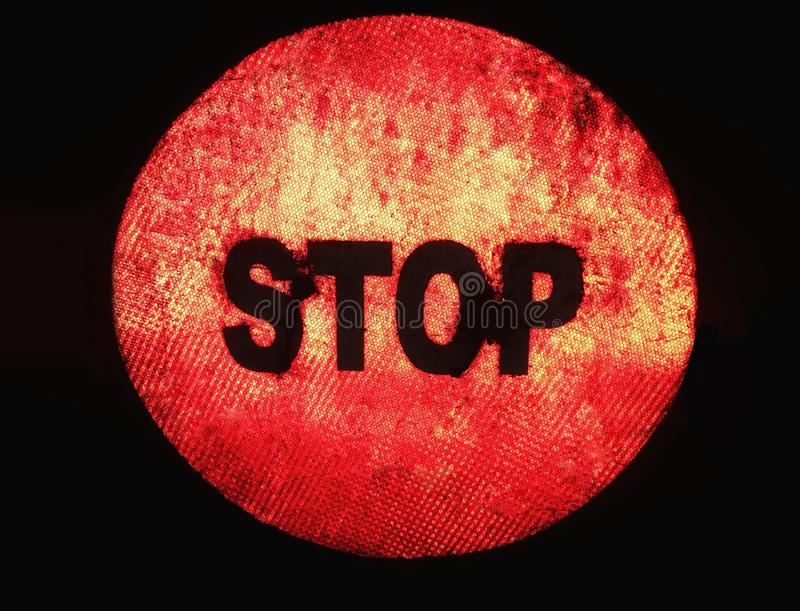 Stop sign at night with dark background royalty free stock image