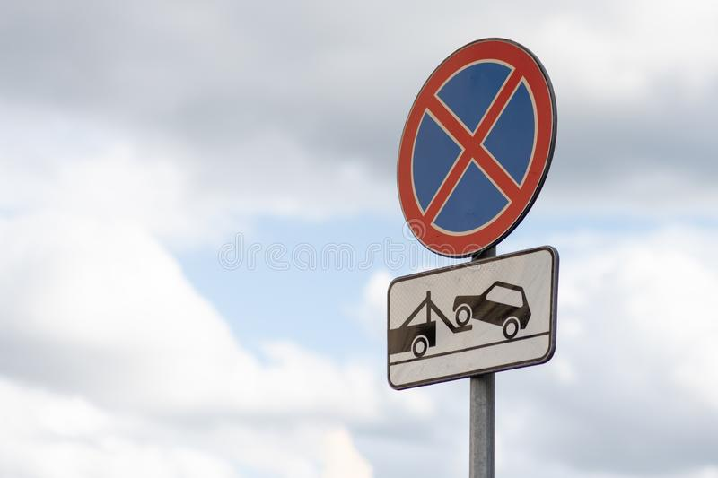Stop sign and no Parking sign with Working tow stock images
