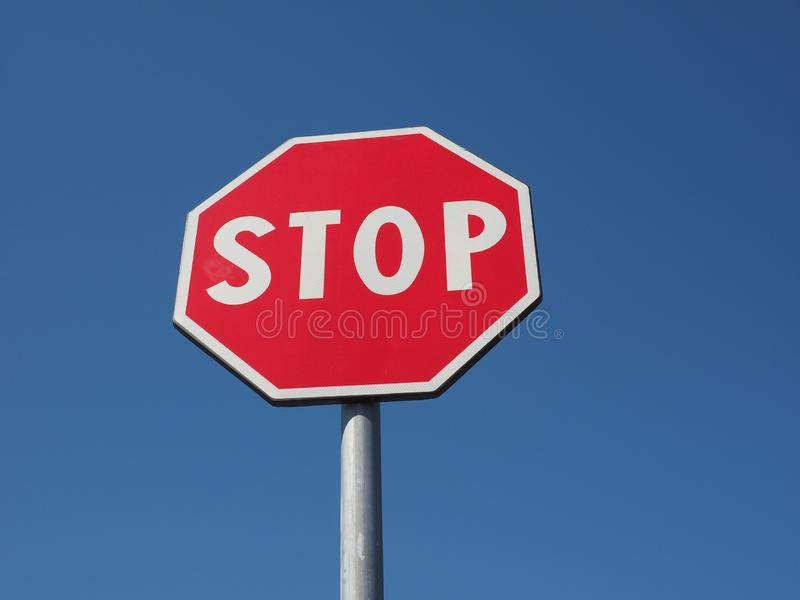 stop sign over blue sky stock images