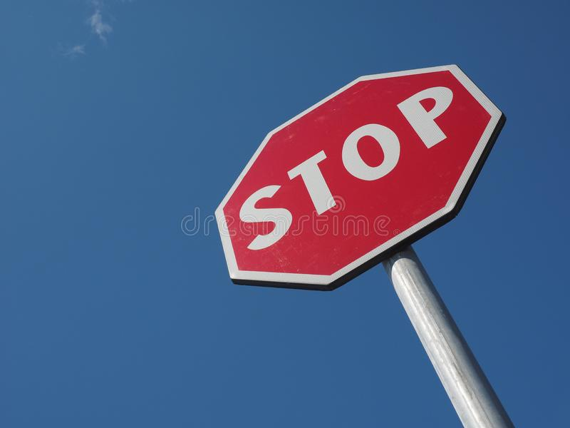 stop sign over blue sky royalty free stock photos