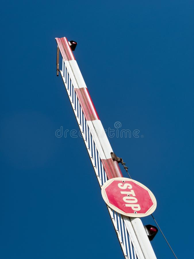 Stop sign. On a raised barrier against blue sky royalty free stock images
