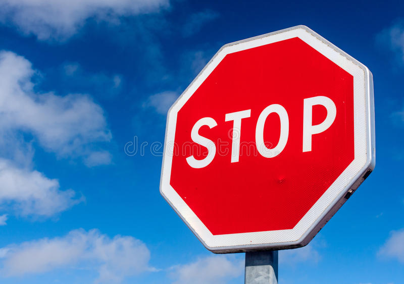 Stop sign. A red stop sign against a deep blue sky royalty free stock photos