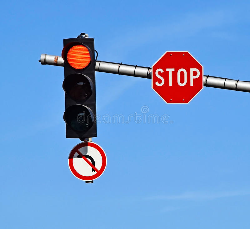 Stop sign and red traffic light royalty free stock images