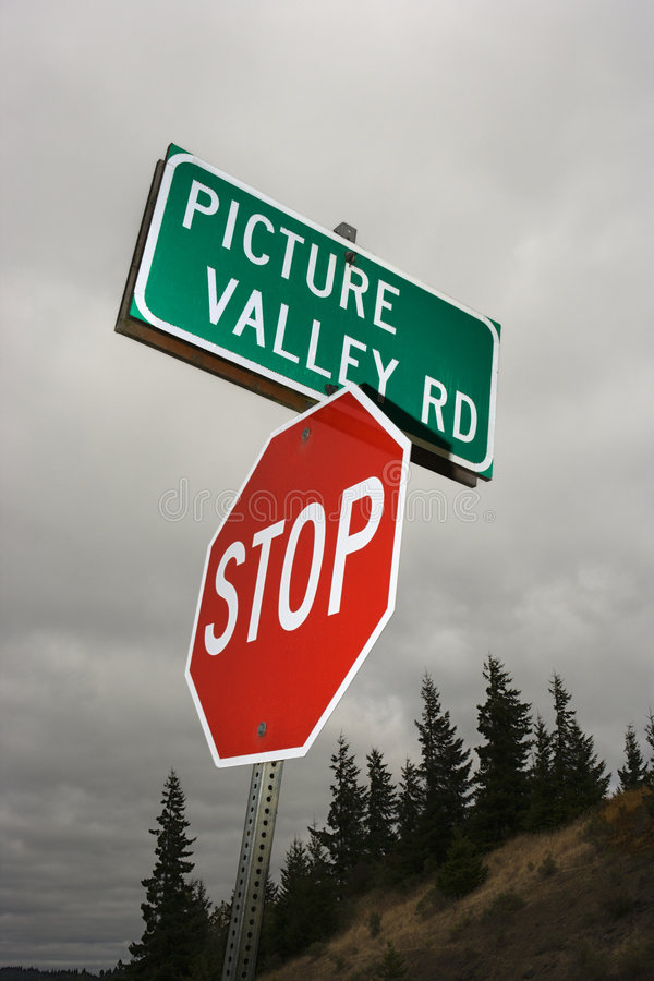 Stop sign and road sign. Stop sign and sign reading Picture Valley Rd royalty free stock images