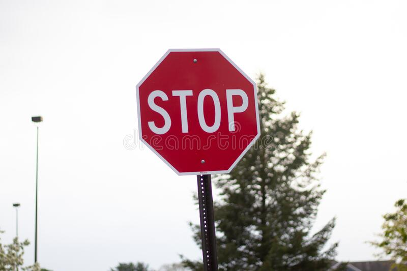 Stop sign on the road in united states royalty free stock image
