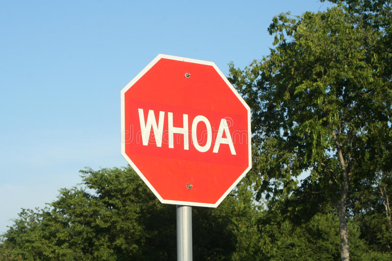Whoa stop sign, Waxahachie, Texas. Red stop sign with text graphics whoa on rodeo grounds in Waxahachie, Texas royalty free stock images