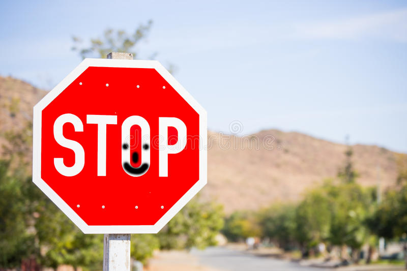 Stop Sign with Smiley Face stock image