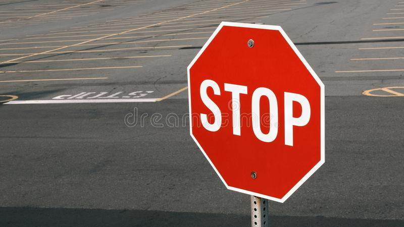 Stop Sign. In front of parking lot. Wide format royalty free stock photo