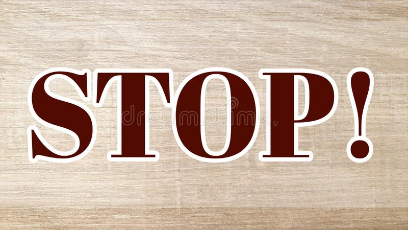 Stop! sign. Stop sign on wooden background in red royalty free stock photography