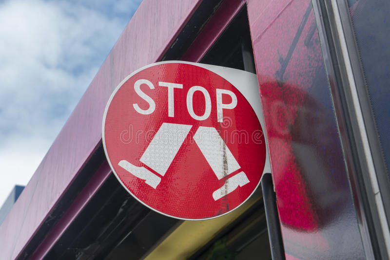 Stop sign on a tram stock images