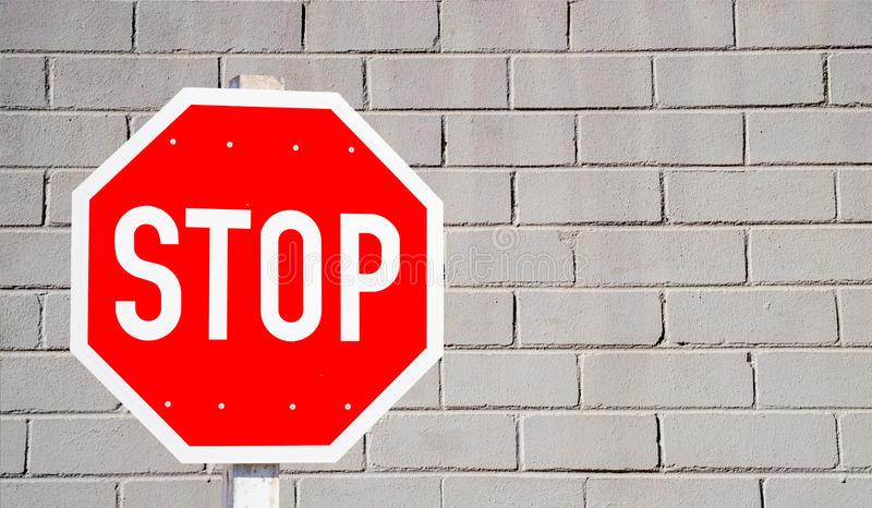 Stop Sign and Wall stock photo