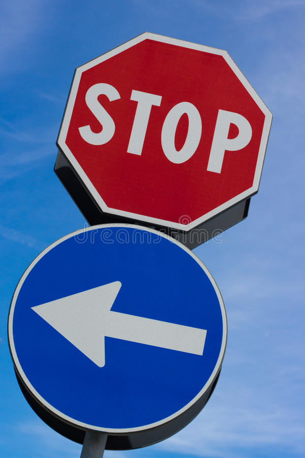 Download Stop Signal With Left Arrow Stock Photo - Image: 25177480