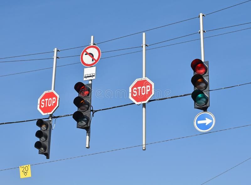 Stop signs and traffic lights at the road crossing stock photos