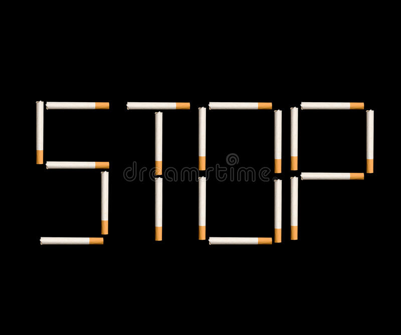 Stop smoking. Sign made of cigarettes on black background royalty free stock photography